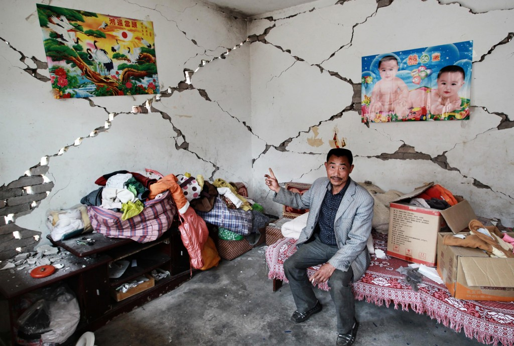 Yang Yuping, 44, shows how is home is damaged by earthquake, at Wangjia village at Longmen, Lushan county, Ya'an city, Sichuan province. 22APR13 Photo by Simon Song/South China Morning Post