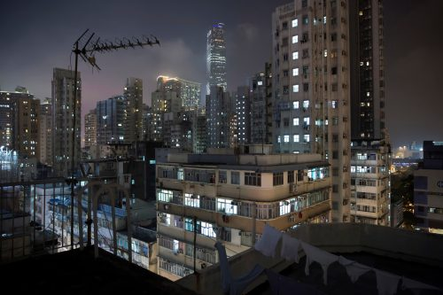"""May 6, 2017 photo, a general view of residential and commercial buildings in Yau Tsim Mong District where is a popular location for the """"subdivided units"""" in Hong Kong. There are estimated 200,000 people in the former British colony living in """"subdivided units."""" That's 18 percent more than four years ago and includes 35,500 children 15 and under, government figures show."""