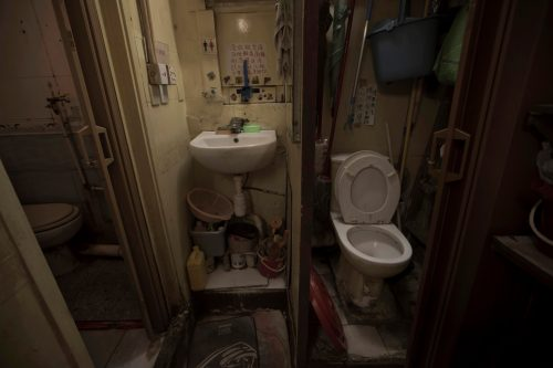 "March 28, 2017 photo, a set of grimy toilets and single sink shared by the coffin home's two dozen inhabitants, including a few single women, is located at a flat in Hong Kong. In wealthy Hong Kong, there's a dark side to a housing boom, with hundreds of thousands of people forced to live in partitioned shoebox apartments, ""coffin homes"" and other ""inadequate housing."